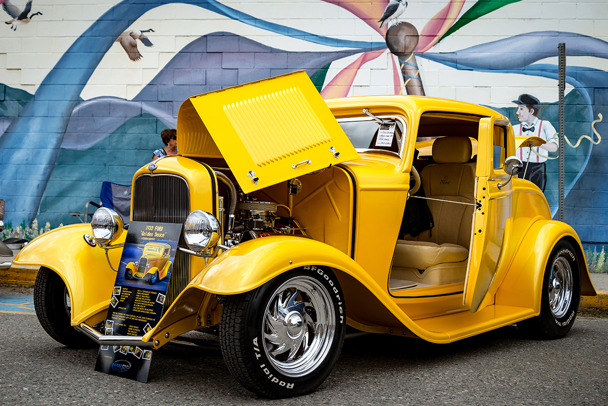 A vintage yellow car during the Kaslo Show n Shine at Kaslo May Days Festival