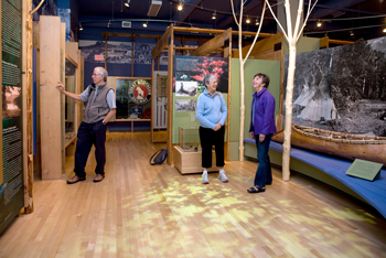 Tourists browsing Touchstones exhibits.