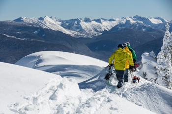 Two skiers touring atop a mountain near Nelson BC