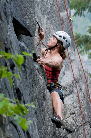 Woman rock climbing near Nelson BC