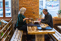 A couple eating at Farm Fresh cafe.
