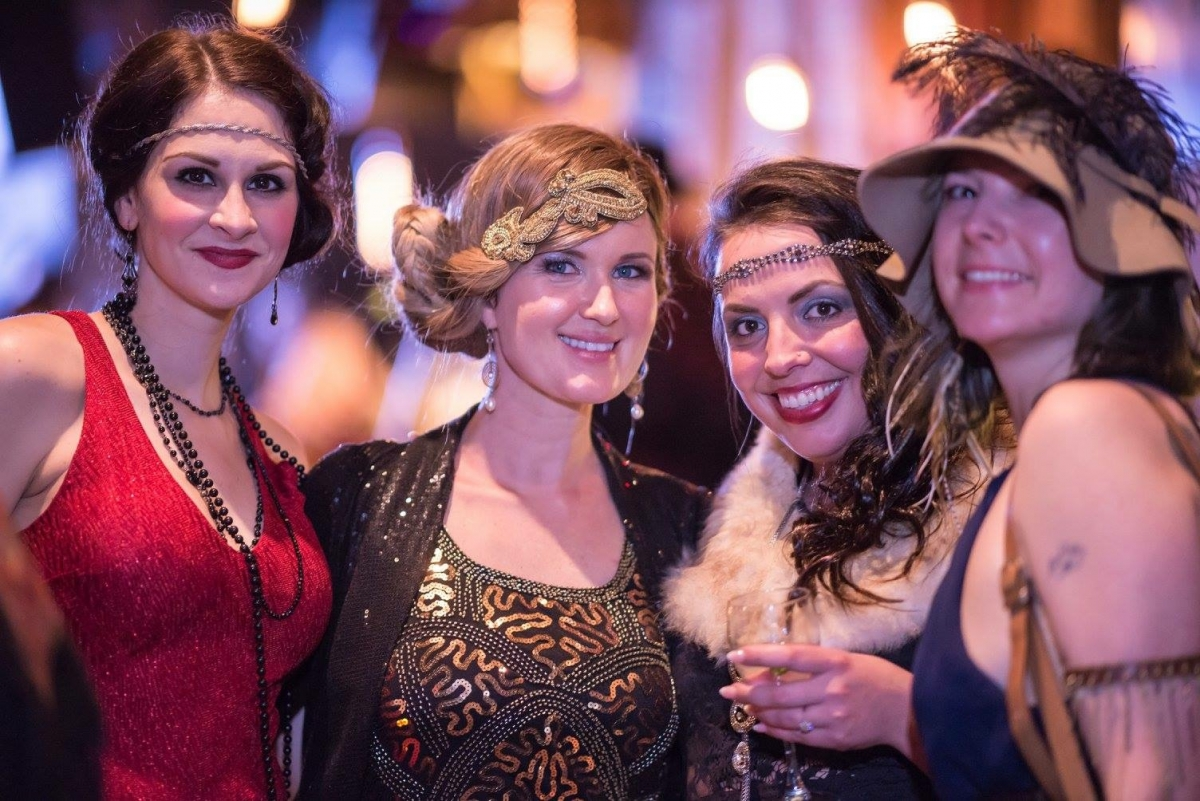 A group a girls dressed in 1920s era clothing at Grapes & Grains festival