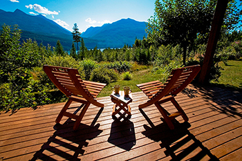 Two chairs on the deck of Wing Creek overlooking Kootenay Lake