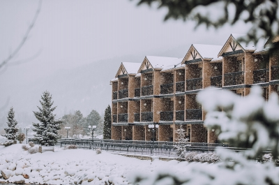 The Prestige Lakeside Resort in Nelson, BC covered in snow.