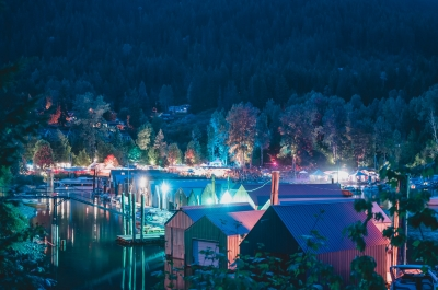 Boathouse in Kaslo, BC illuminated with multi colour lights during the annual Kaslo Jazz Festival