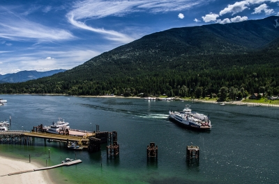 Aerial of the Kootenay Lake Ferry coming into the Balfour Ferry Terminal.