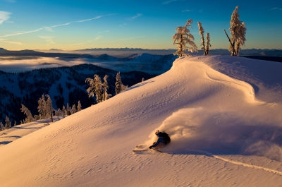 A skiier at Whitewater Ski Resort during golden hour