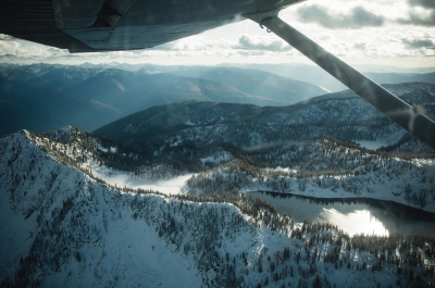 Looking out of an airplane window at Kokanee Glacier Provincial Park