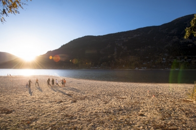 A group playing volley ball on the beach at Lakeside Park in Nelson, BC.