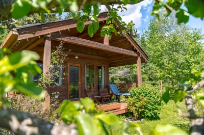 A cottage in the woods at Wing Creek Resort in Kaslo, BC.