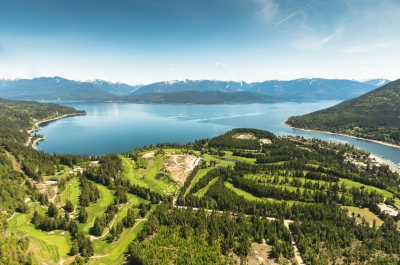 An aerial view of Balfour, BC, including Kootenay Lake and the golf courses.