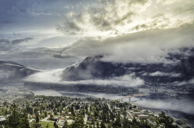 Aerial view of Nelson BC and Kootenay Lake with low hanging cloud.