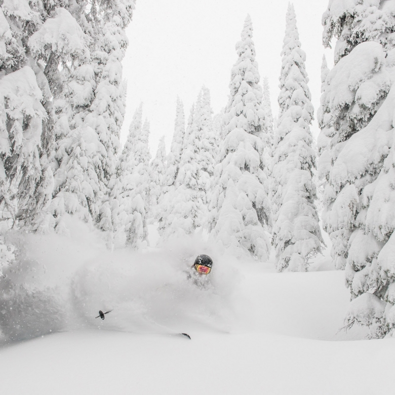 A skiier in deep powder at Whitewater Ski Resort near Nelson, BC.