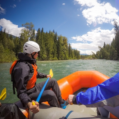 Three people river rafting in Lardeau, a half-day adventure near Kaslo BC and Nelson BC