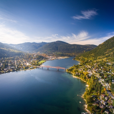 Aerial photo of Nelson, BC in the Fall, looking down the lake to Big Orange Bridge