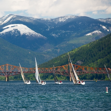 Sailboats on Kootenay Lake with the Big Orange Bridge in the background.