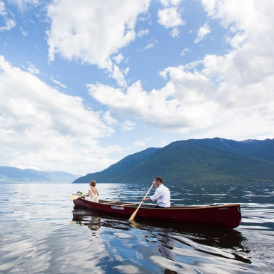 A bride and groom in a canoe on Kootenay Lake near Nelson, BC.