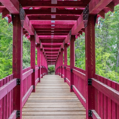 One of the large red bridge along the Kaslo River Trail
