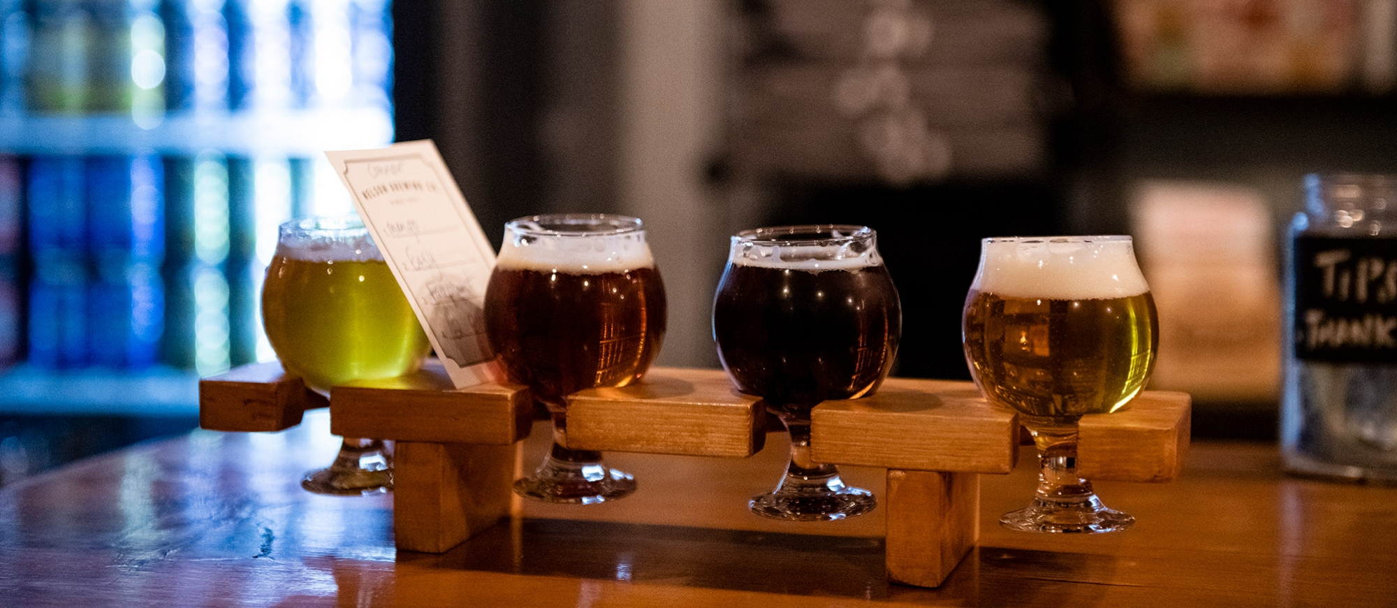 A flight of four beers on the counter of Nelson Brewing Company.
