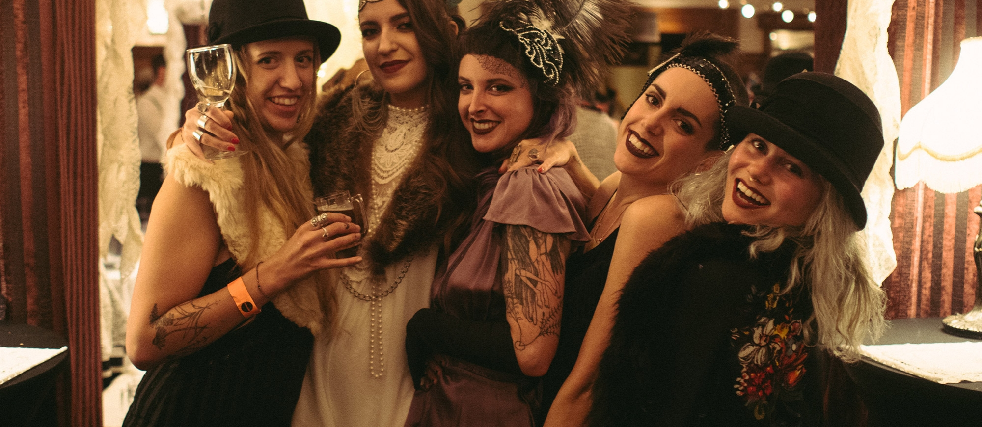 Five women dressed in 20s attire at Grapes & Grains Festival in the Hume Hotel