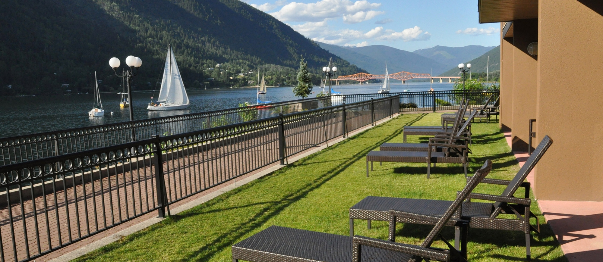 View of the waterfront walk on a sunny day, by the Prestige Lakeside Resort in Nelson BC