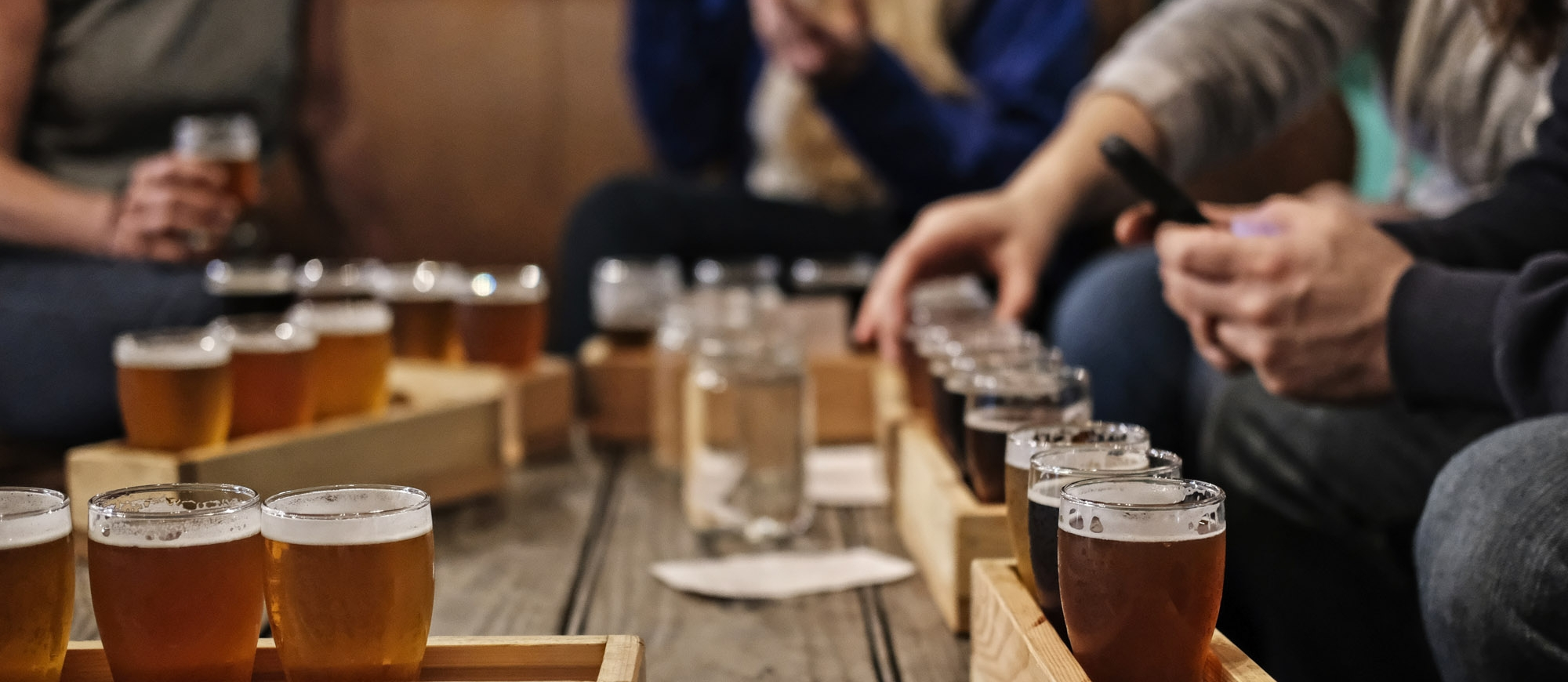 A number of beer flights on a table at Backroads Brewing Co in Nelson, BC.
