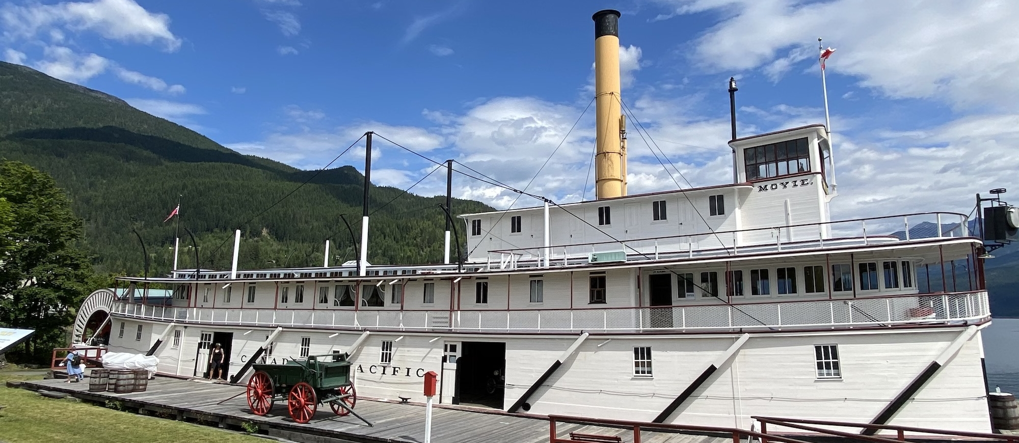 the SS Moyie and Visitor Centre sits with mountains in the background in Kaslo, BC