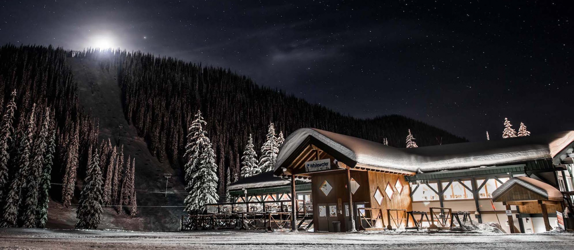 The stars and moonlight light up the Whitewater Ski Resort Lodge at night