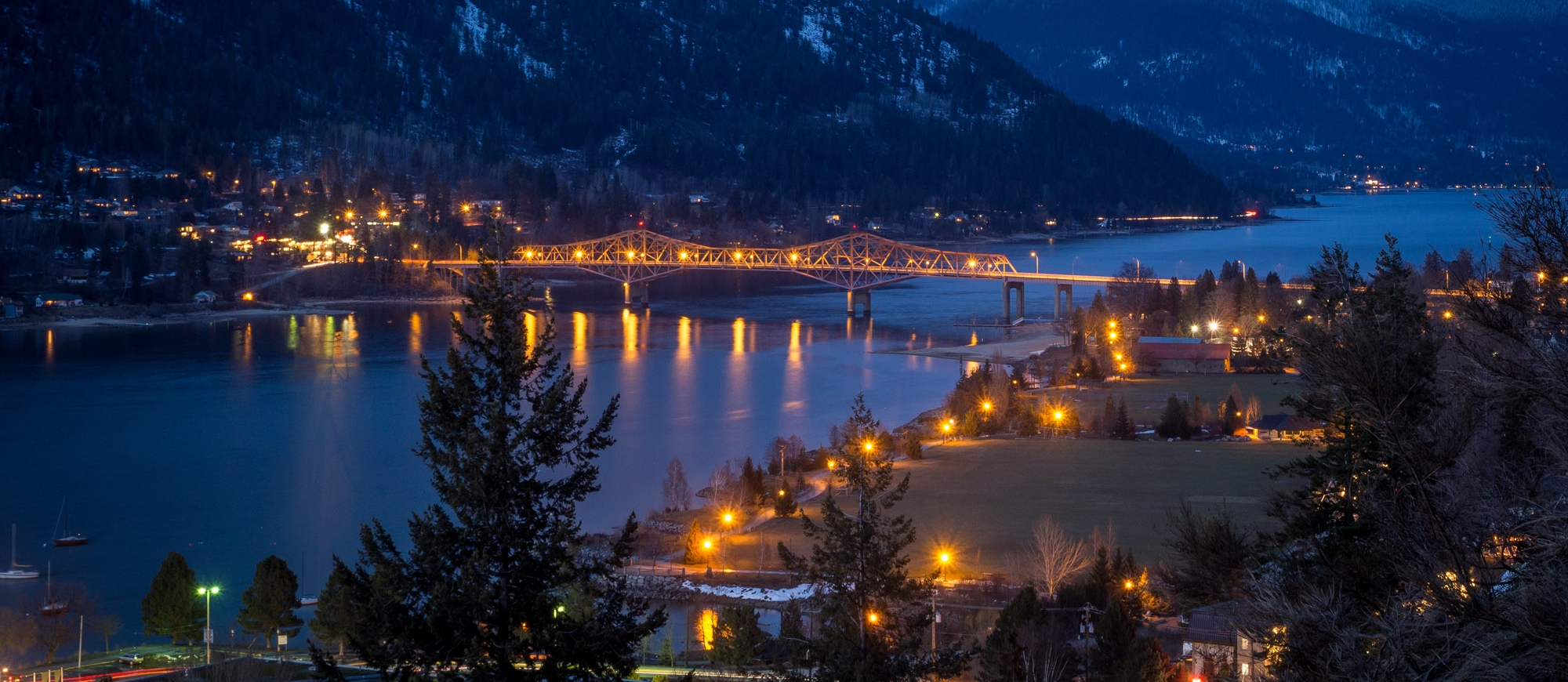 Nelson, BC and the Big Orange Bridge lit up at night.