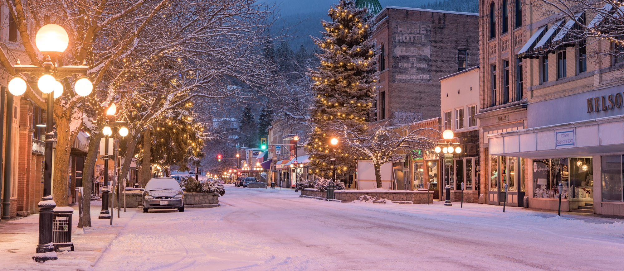 Nelson BC in the evening light covered with snow and lit up by Christmas Lights