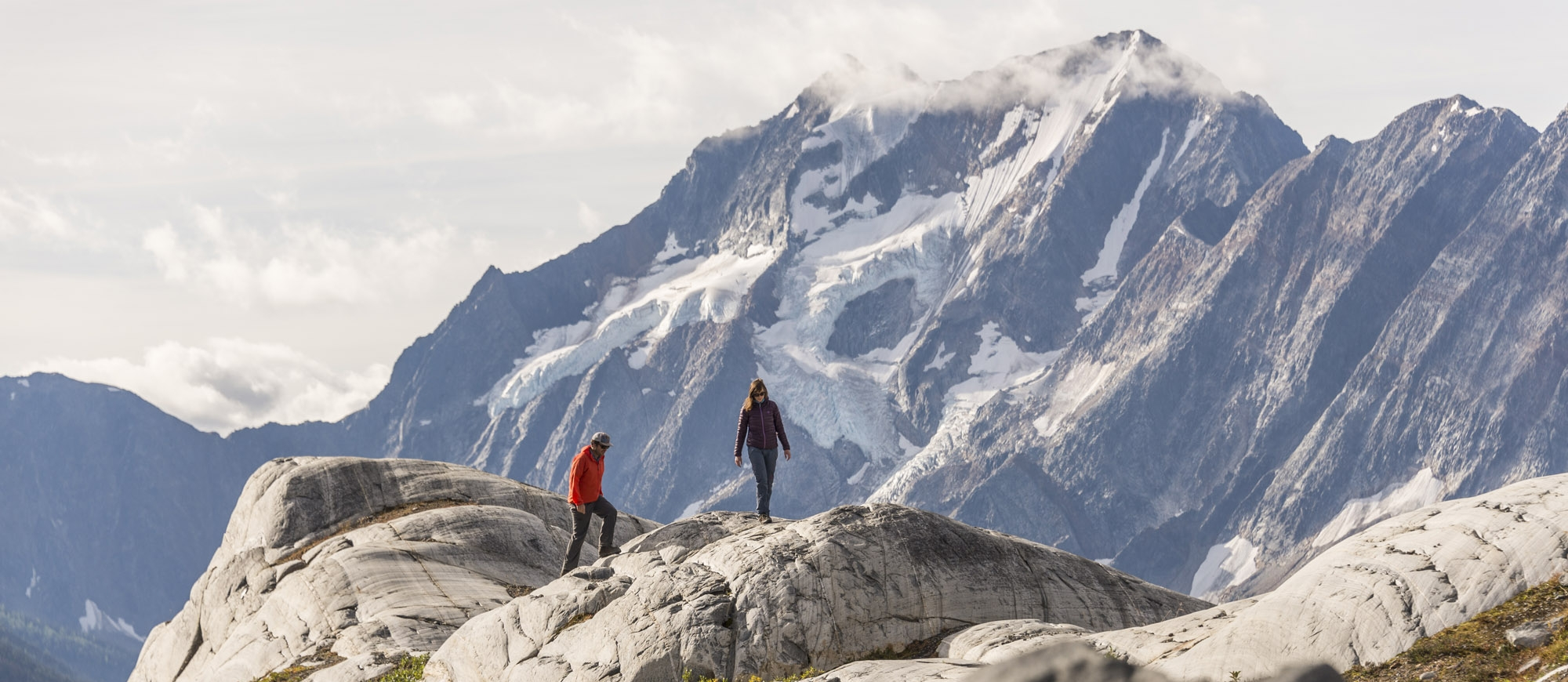 Two hikers at MacBeth Icefield in the Purcell Mountains near Nelson and Kaslo, BC.