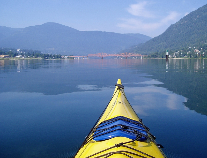 Kayaking the pristine waters of Kootenay lake, Photographer Phil Best