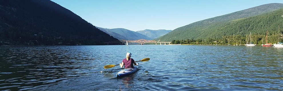 Kaddling on Kootenay Lake with the Big Orange Bridge in the background.