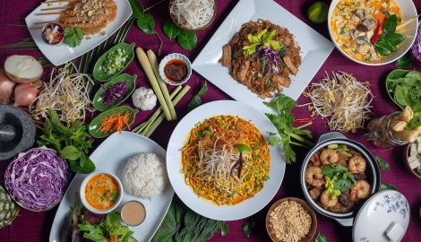 A table with a variety of colourful food at Busaba Thai Cafe in Nelson, BC