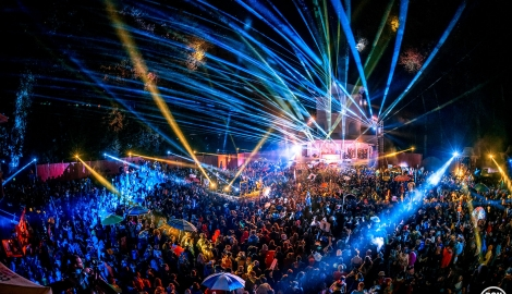 fans fill the dancefloor of the Pagoda Stage as it lights up with blue lazer lights at Shambhala Music Festival