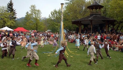 Kids doing the traditional May Pole dance during Kaslo May Days.