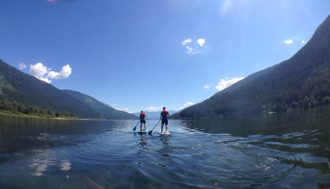 Two paddle boarder out front of Kokanee Creek Provincial Park.