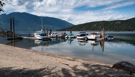 View of the marina with mountains in the background at The Lakeview in Gray Creek near Crawford Bay, BC