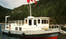One of Kaslo Shipyard's houseboats on the shore of Kootenay Lake.