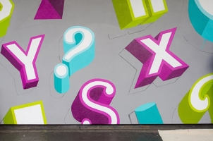 Alex Fowkes working on an large typographic mural.