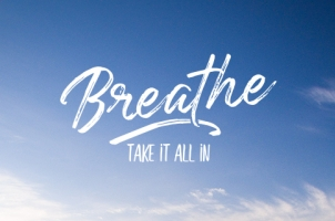 "A blue sky with the text ""Breathe, take it all in""."