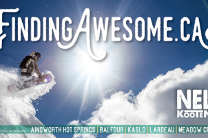 Snowboarder at Selkirk Wilderness Skiing billboard.