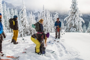 A group of skiiers listening to their instructor in the Whitewater backcountry.